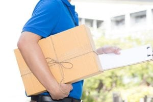 Parcel being carried by a delivery man