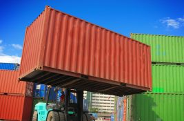 Container being hauled in shipping yard