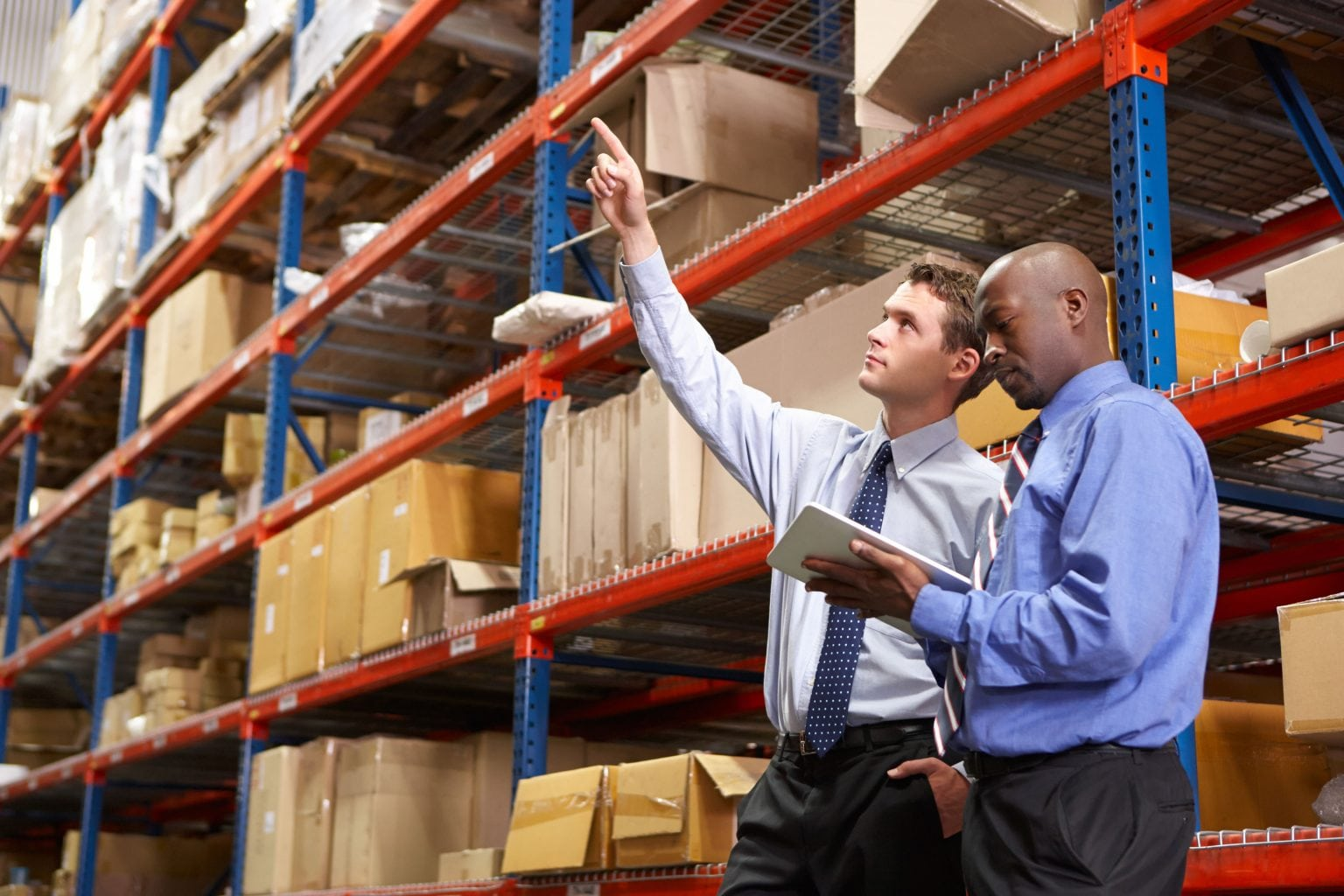 Two men checking inventory at a warehouse
